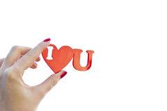 I love you. Woman hand is holding the red shape I love you symbol phrase with an empty space on white stock image