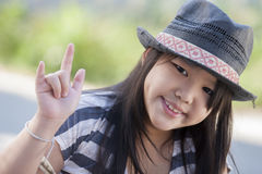 I love you. Ute Asian girl showing hand symbol (I love you Royalty Free Stock Photo