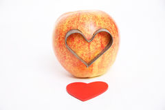I love you. Apple love with red color hearts background Royalty Free Stock Photo