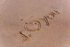 I love you. Sand heart royalty free stock photo