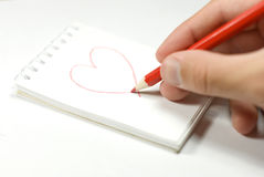 I love you. A piece of paper with heart drawing Stock Photos