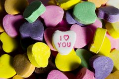 I Love You. Pile of heart shaped valentine's candy with white heart in center that says I Love You Stock Photography