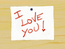 I love you!. Drawing a wooden panel with a ticket and posted a message written by hand Stock Photo