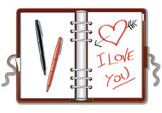 I love you. This illustration is an organizer open. On a blank page is drawn a heart and the inscription I love You, alongside two markers are placed Stock Photo