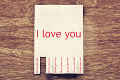 I love you on advertising paper notice and tear off feedback of. Love. Valentine concept Royalty Free Stock Photography