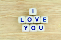 I LOVE YOU ALPHABET BLOCKS. Blue Alphabets on White Cube Blocks say I LOVE YOU on the Wooden Surface Background Royalty Free Stock Photography