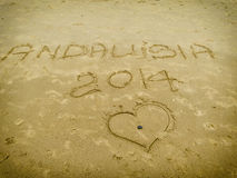 I love you, Andalusia, written on beach sand Royalty Free Stock Photo