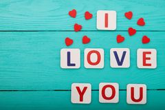 I love you on blue wooden background. Top view. Mock up. Copy space. Mother valentine day. Colorful word love on blue wooden background. Top view. Mock up. Copy stock image
