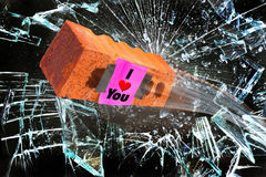 I love You. I love you brick going through  glass window Stock Image