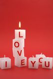 I love you candles. Blocks of candles saying I love you with top candle lit Stock Photos