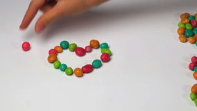 I love you. Of colored round candy time lapse stock video