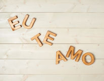 I love you composition. Eu Te Amo meaning I Love You in Portuguese written with the block letters over the wooden background Stock Photography