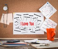 I love you Concept. Chart with text in different languages. Communication and love background. Wooden office desk with a big mess Royalty Free Stock Photos