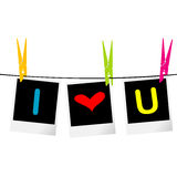 I love you concept with photo frames hanging on rope and colored Royalty Free Stock Photo