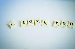 I Love You Concept. I Love You written with Scrabble pieces on white background royalty free stock photography