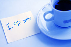 I love you. Cup of coffee and note I love you on a table Royalty Free Stock Image
