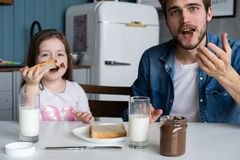 I love you, dad! Handsome young man at home with his little cute girl are having breakfast. I love you, dad! Handsome young men at home with his little cute royalty free stock photos