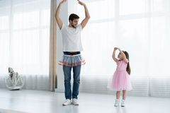 I love you, dad! Handsome young man is dancing at home with his little girl. Happy Father`s Day!. I love you, dad! Handsome young men is dancing at home with his stock image