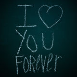 I love you forever. Sentence I love you forever written with chalk in a chalkboard royalty free stock image