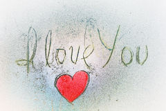 I LOVE YOU hand lettering and red heart shape. On a wall stock images