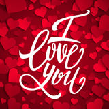 I love you handwritten brush pen lettering on red hearts background, Valentine's Day. Vector illustration Royalty Free Stock Image