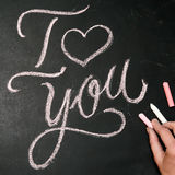 I Love You. Handwritten message on a chalkboard with hand Royalty Free Stock Image