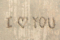 I love you handwritten in sand for natural Stock Photo