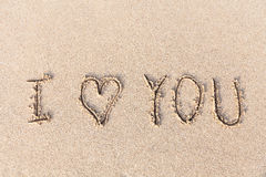 I love you handwritten in sand for natural Stock Images