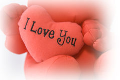 I love you heart. A red teddy bear holding the heart that says I Love You Stock Photo