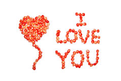 I love you. Heart and I love you, laid out by pomegranate grains on a white background Stock Photos