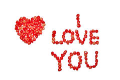 I love you. Heart and I love you by pomegranate grains, isolated. Edible declaration of love Royalty Free Stock Photos