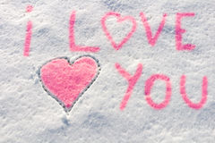 I love you with heart sign writing on the snow. Stock Images