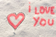 I love you with heart sign writing on the snow. Stock Image