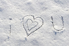 I love you with heart sign writing on the snow. Stock Photo
