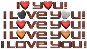 I Love You - Hearts and Metal Letters. Set of I Love You! written with typefaces in metal with stone and wooden hearts Royalty Free Stock Images