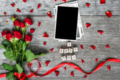 I love you inscription with blank photo frame and red roses Royalty Free Stock Image