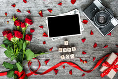 I love you inscription with blank photo frame, vintage retro camera and red roses Stock Photos