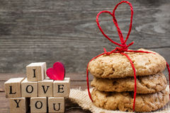 I Love You Inscription With Wooden Heart And Pile Of Homemade Cookies Stock Photos