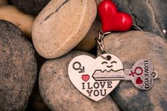 I love you Key chains in heart shaped with red heart on Stones,. Vintage style. Happy Valentine`s Day concept royalty free stock photos