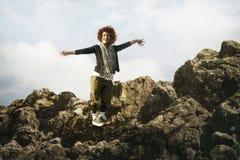 I love you, life!. Happy girl on high rock stock image