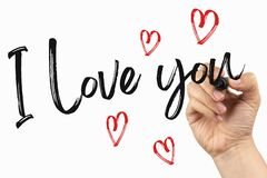 I love you with little hearts. Doodle  on a whiteboard, written with black marker in a hand. Scribble sketch text