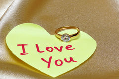 I love you. Marriage proposal card. Ring with diamond and inscription I love you on valentine heart from paper royalty free stock image