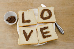 I love you message on bread. I love you message on white bread on a plate with a knife Royalty Free Stock Images