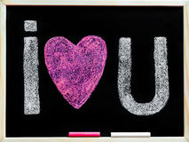 I love you message hand written with chalk on blackboard Royalty Free Stock Photo