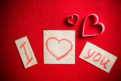 I love you message handwritten with lipstick on red background. Stock Photo