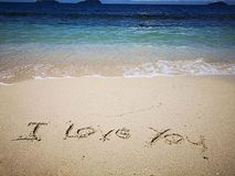 I love you a message on the sandy beach for lovely couple stock photo