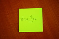I love You message on the table. I love You message on the wooden table Royalty Free Stock Images