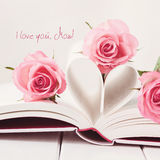 I love you, mom. A book with heart-shaped pages and pink roses Royalty Free Stock Photos