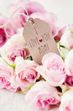 I love you, mom. A bunch of roses and a mother's day greeting card Stock Image