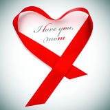 I love you, mom. A red satin ribbon forming a heart and the sentence I love you, mom Stock Images